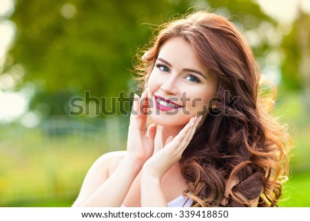 Portrait of beauty young woman with long curly hair