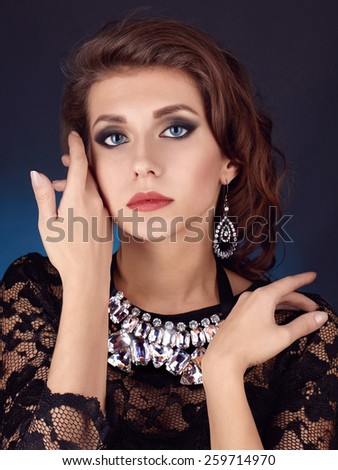 portrait of beautyful brunette woman with jewelery.face of young model.make-up - stock photo