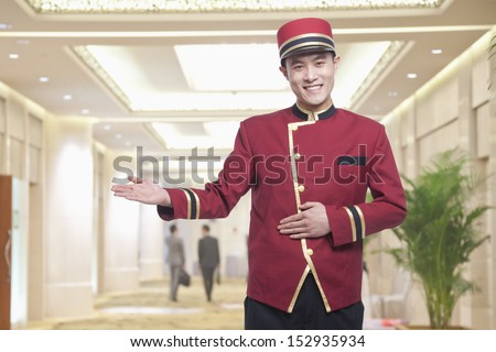 Portrait of Bellhop, Greeting - stock photo