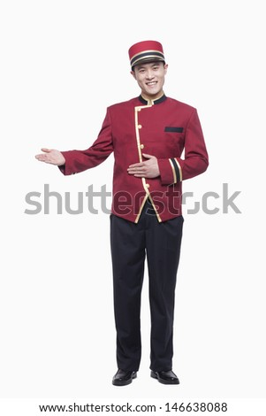Portrait of Bellhop, Greeting, studio shot - stock photo