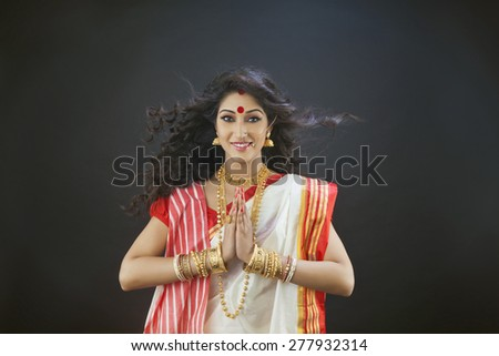 Portrait of Bengali woman greeting - stock photo
