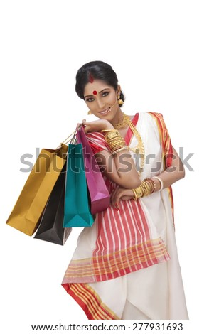Portrait of Bengali woman holding shopping bags