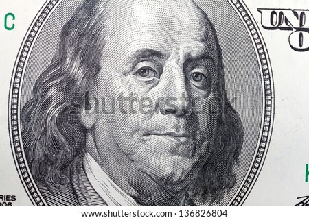 Portrait of Benjamin Franklin from 100 dollars bill - stock photo