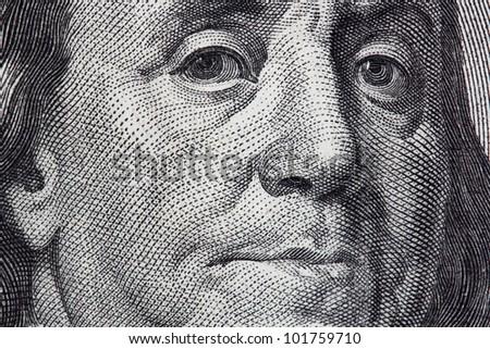 Portrait of Benjamin Franklin from one hundred dollar bill - stock photo