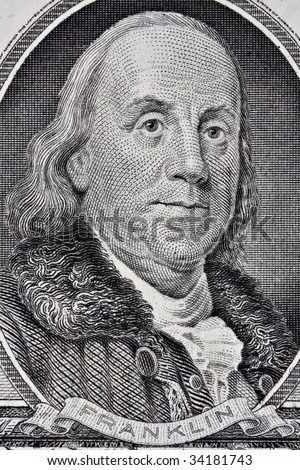Portrait of Benjamin Franklin from the one hundred dollar bill.  This is an old style bill. - stock photo