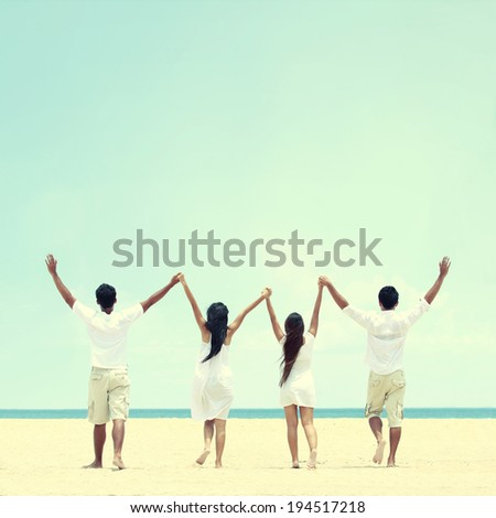 Portrait of best friend in white together holding and raise each other hand - stock photo