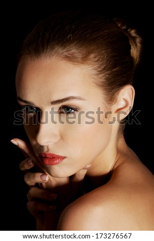 Portrait of beutiful caucasian woman. On black background.