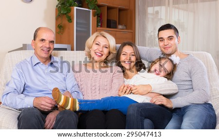 Portrait of big smiling multigenerational family on sofa in living room