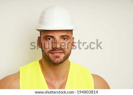 Portrait of big worker at protective helmet, with copy space.
