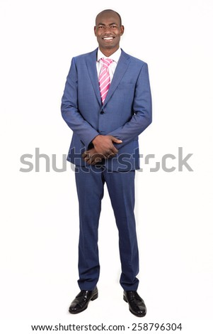Portrait of black businessman wearing suit and tie smiling on white background. Studio shot - stock photo