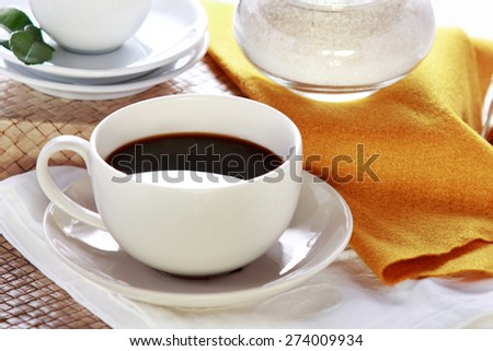 portrait of black coffee in a white cup - stock photo