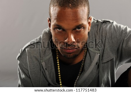Portrait of Black young man isolated on a neutral background