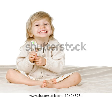 portrait of blond boy with tooth brush on white - stock photo