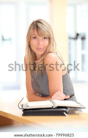 Portrait of blond businesswoman with agenda - stock photo