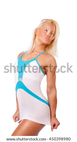 Portrait of blond female in sports dress isolated on a white background.