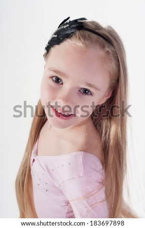 Portrait of blond girl with long hair in studio - stock photo
