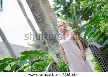 portrait of blond woman in long  dress outdoor - stock photo