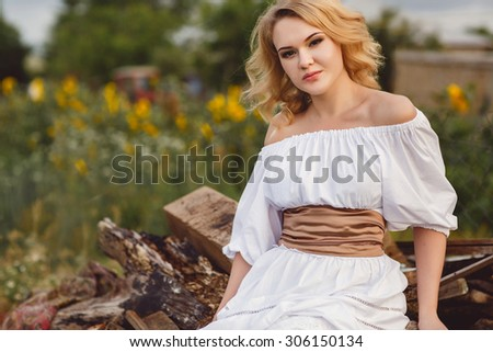 portrait of blond woman in white dress outdoor. closeup of beautiful girl in long white dress outdoors.blonde beautiful woman