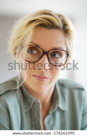 Portrait of blond woman with eyeglasses on
