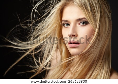 Portrait of blonde girl with fluttering hair - stock photo