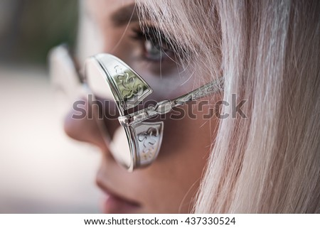 Portrait of blonde model outdoors - stock photo