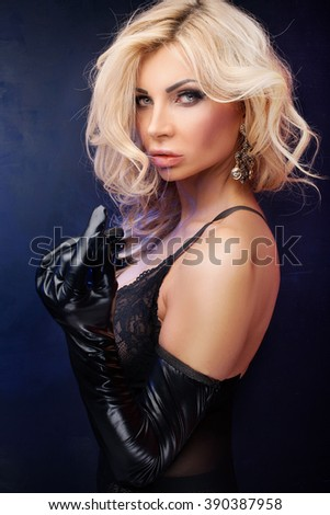 Portrait of blonde sexy woman looking at camera. Ideal body. Glamour makeup. Studio shot. - stock photo