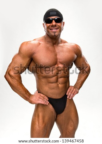 Portrait of bodybuilder on a white background - stock photo
