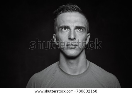 Portrait of bodybuilder shoor in studio on black background