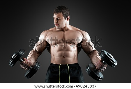 Portrait of bodybuilder with dumbbells