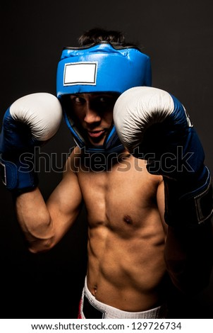 Portrait of  boxer in the dark - stock photo