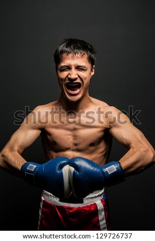 Portrait of  boxer in the dark screaming