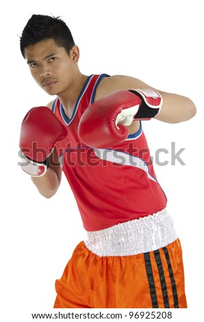 Portrait of boxer poses punch style. - stock photo