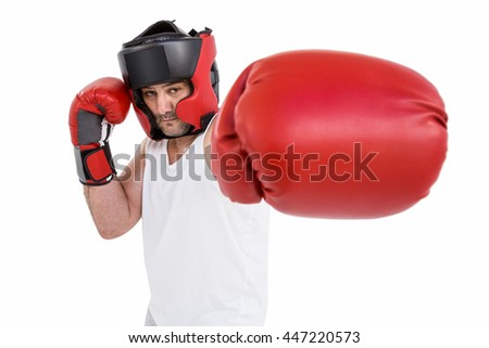 Portrait of boxer wearing head protector and gloves isolated on white background
