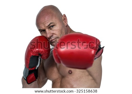 Portrait of boxer with fighting stance against white background