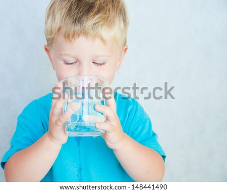 Portrait of boy drinking glass of water