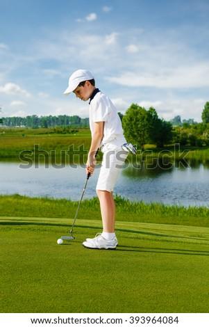 Portrait of boy golfer  - stock photo
