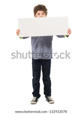 Portrait Of Boy Holding Placard Isolated On White Background - stock photo