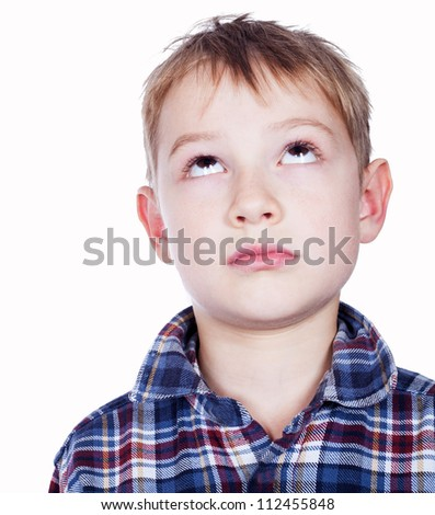 Portrait of boy looking up - stock photo