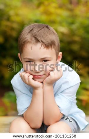 portrait of boy outdoor - stock photo