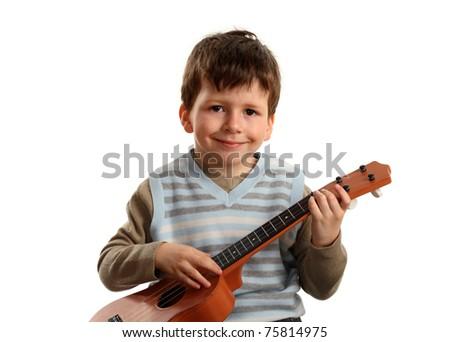 Portrait of  boy practicing playing guitar isolated on white background