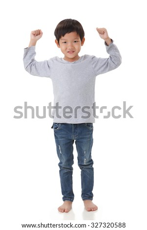 portrait of boy standing in cheer up mood. Isolated on white background - stock photo