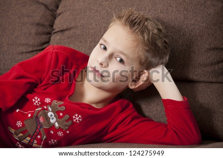 Portrait of boy wearing pajama on the sofa