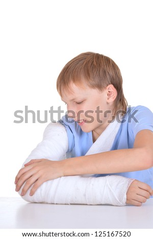 portrait of boy with a broken arm