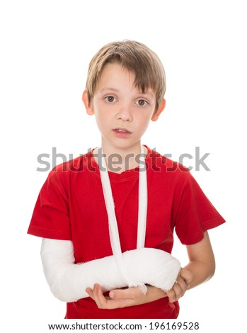 portrait of boy with a broken arm, isolated over white - stock photo
