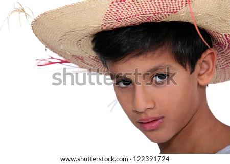 Portrait of boy with big hat - stock photo