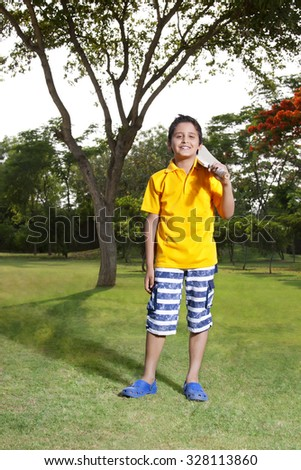 Portrait of boy with cricket bat - stock photo