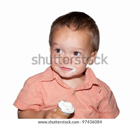 portrait of boy with his mouth smeared with ice cream on white background