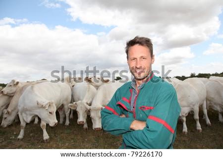 Portrait of breeder standing in farmland - stock photo