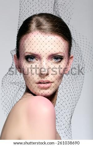 Portrait of bride beauty. Amazing girl posing in black veil. - stock photo