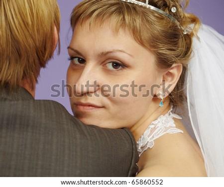 Portrait of bride near to groom - stock photo